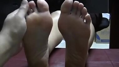 Mature Asian bare feet and tickle