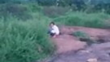 Sri Lankan girl piss on a rock